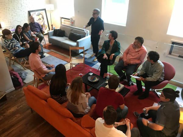 Professor David Gerstner presents to students during a recent evening reception with the French director, Christophe Honore (seated second from Gerstner's left).