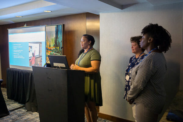 Lisa Thompson, a first-grade teacher at P.S. 78 (speaking), Dr. Irina Lyublinskaya, director of the CSI Discovery Institute, and Sharon Cameron, a fourth-grade teacher at P.S. 45 at the Noyce Summit in July.
