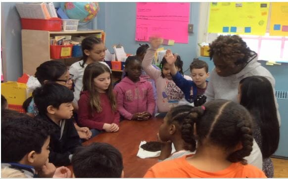 Students at a Staten Island elementary school participate in a science lesson. The CSI Noyce Masters Teaching Fellows Academy is improving science teachers' knowledge and skills - and increasing student interest in science as a result.